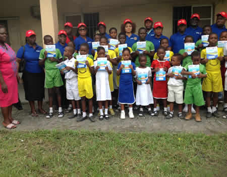 Rotary Club distributes free exercise books to pupils in Delta